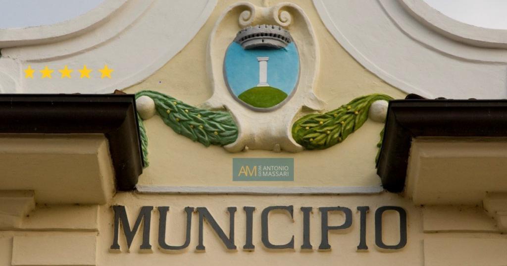 Immagine della facciata di un edificio con scritto municipio per raffigurare i servizi comunali a Roma del geometra massari